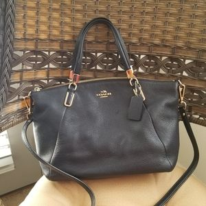 Coach pre used (once used)
